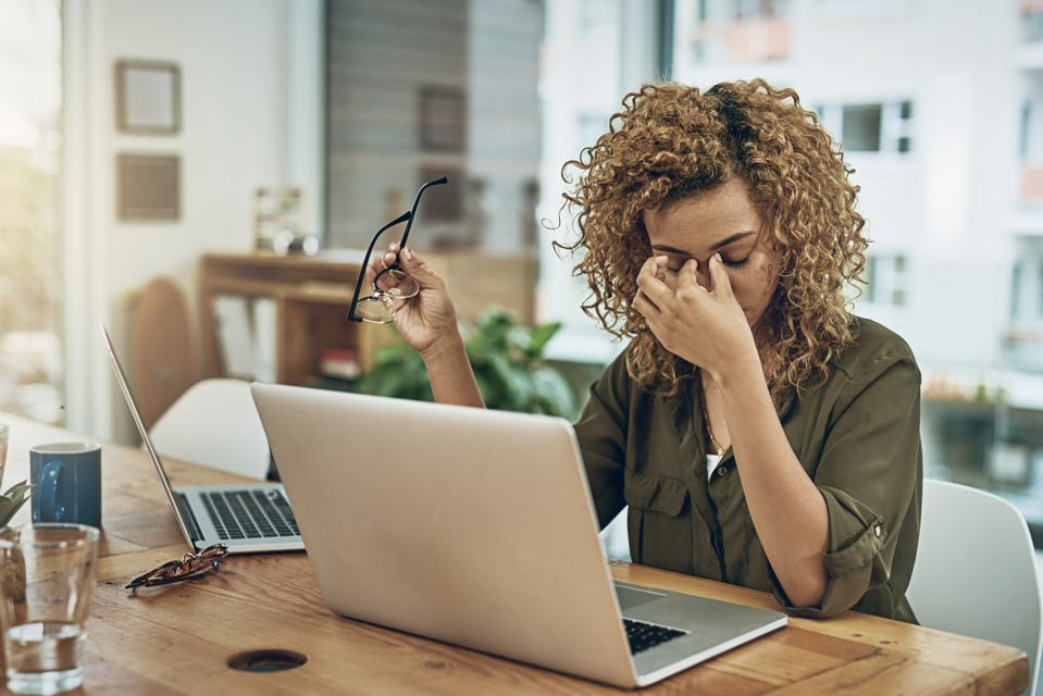 A woman dealing with workplace stress because of coronavirus stress