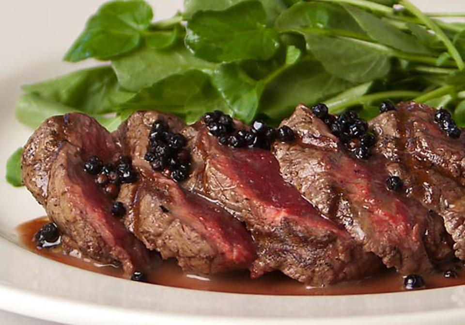 Steak with red wine peppercorn sauce.