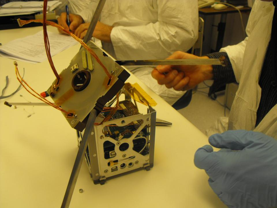 Student technicians build satellite