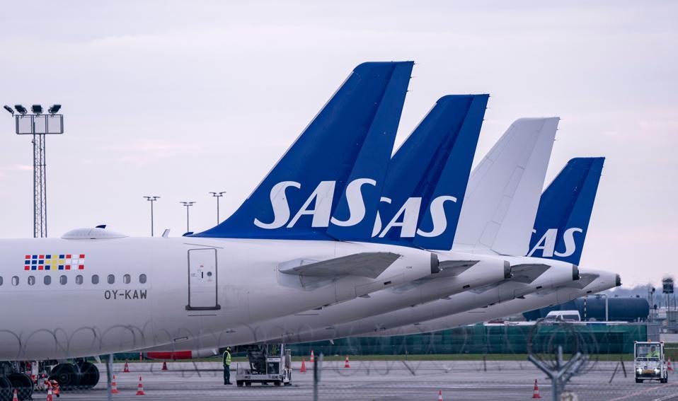 Scandinavian Airlines (SAS) Airbus A320 planes parked at Copenhagen Airport, Denmark.