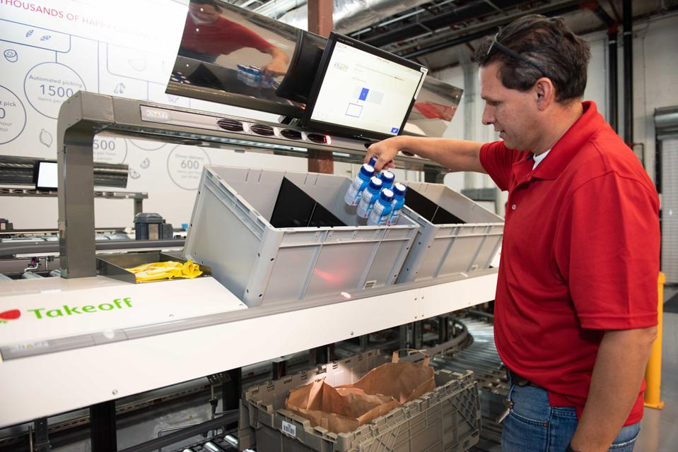 MFC operator picks merchandise for order fulfillment. #takeoff #mfc #retail #online #groceries