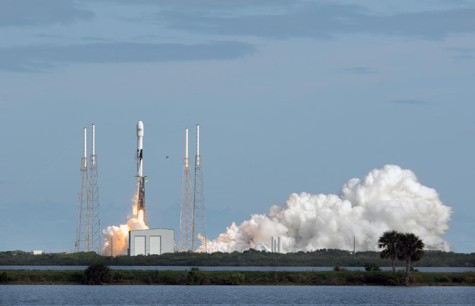 A SpaceX Falcon 9 rocket lifts off from Cape Canaveral Air...