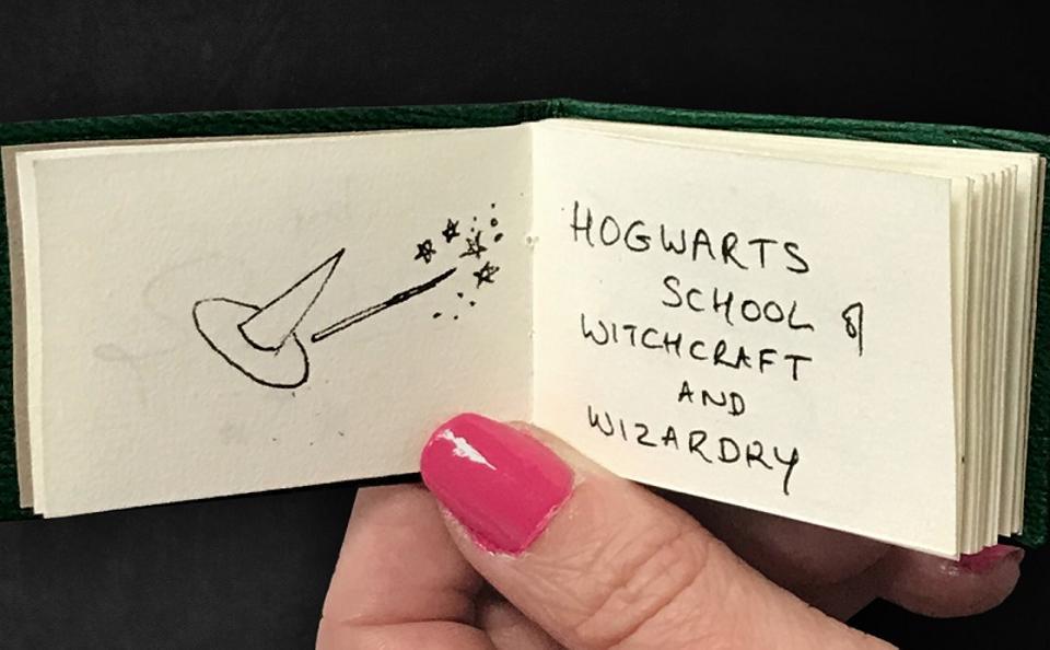 Miniature 'Harry Potter' book handwritten by J.K. Rowling in 2004.