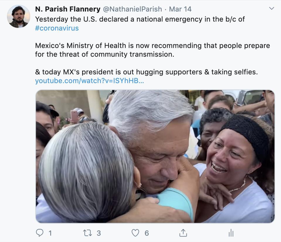 Lopez Obrador hugging supporters.