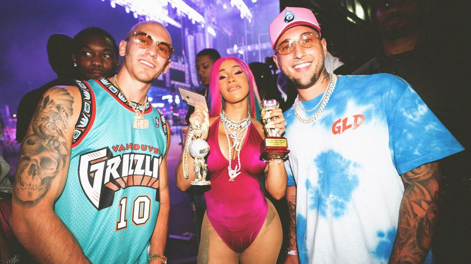 Cardi B wearing GLD with founders Christian Johnston and Dan Folger