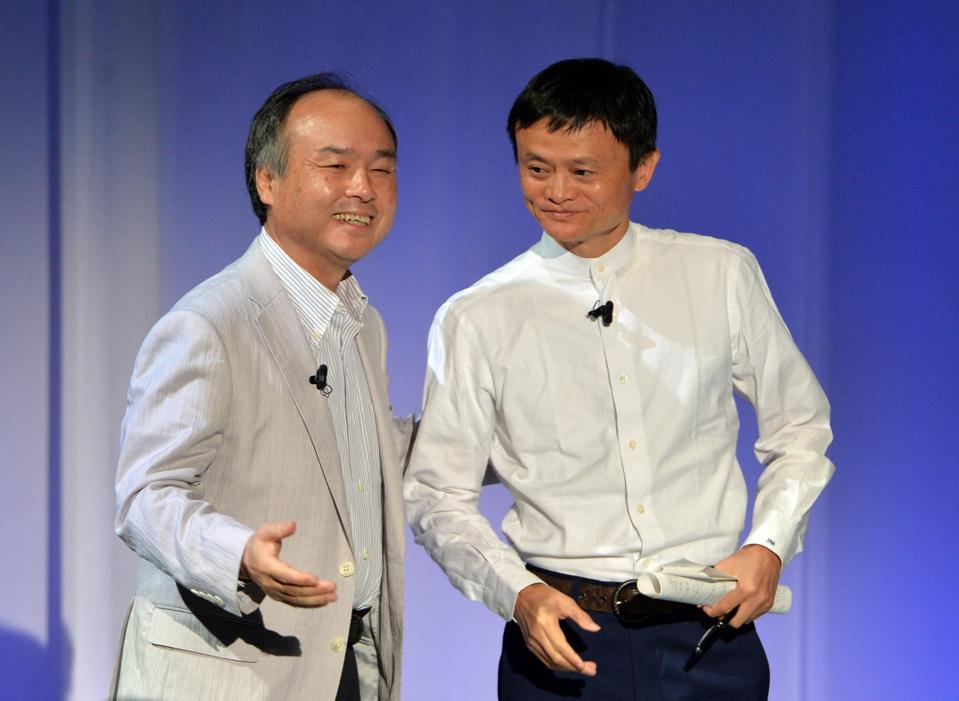 Masayoshi Son introduces Alibaba's Jack Ma.