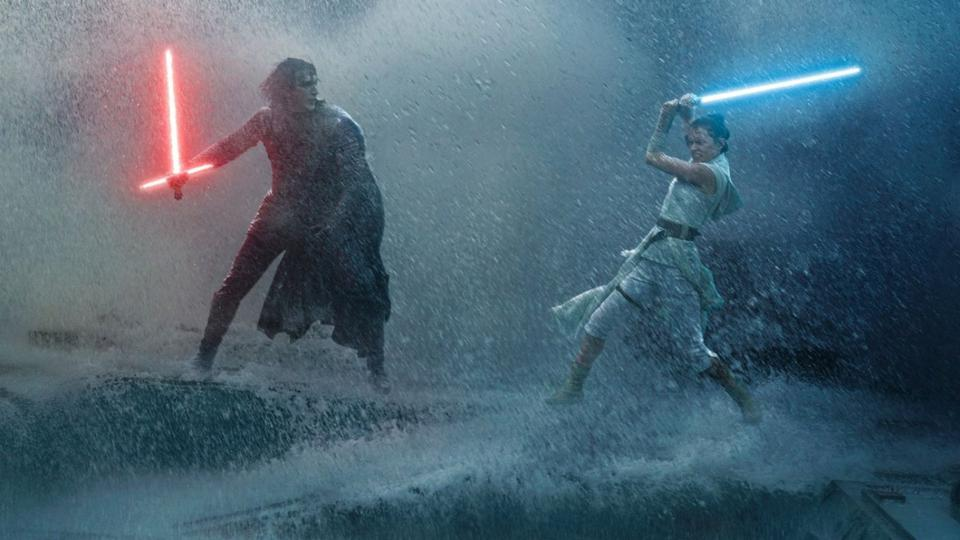 Rey and Kylo Ren battle with their lightsabers