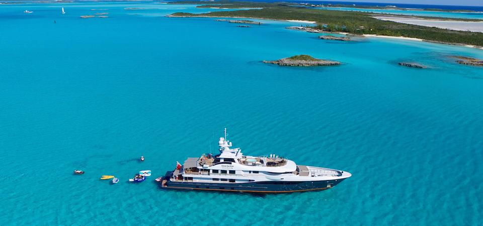 Jonathan Rothberg's 180-foot-long Amels superyacht at anchor with all it's toys deployed