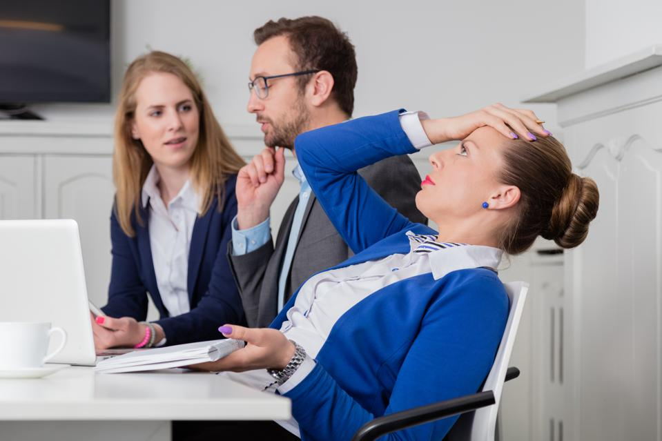 Dissatisfied businesswoman on a meeting