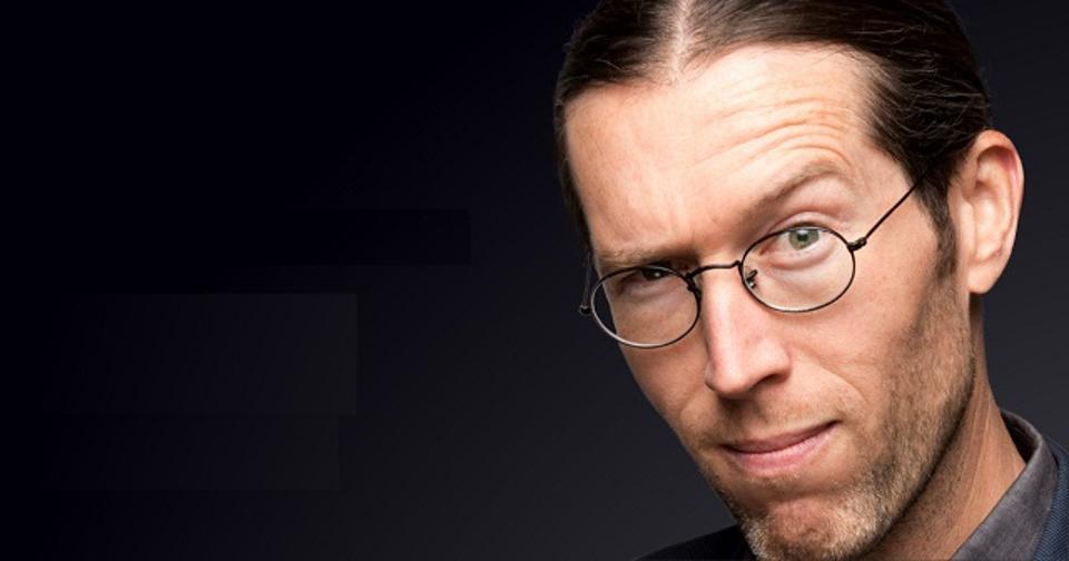 Greg Shields, an author evangelist with Pluralsight, pictured raising one eyebrow in a headshot.