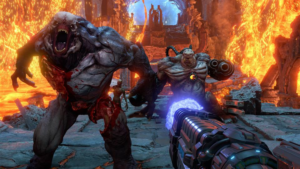 A hell knight and mancubus in DOOM Eternal.