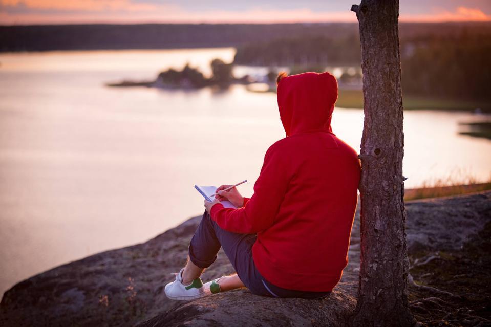 Reading book lake Finland
