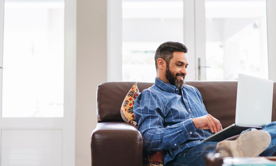 Guy on couch with laptop