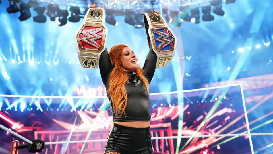 Becky Lynch celebrates after winning the main event of WrestleMania 35.