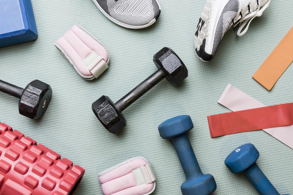 View from above dumbbells and exercise equipment - knolling