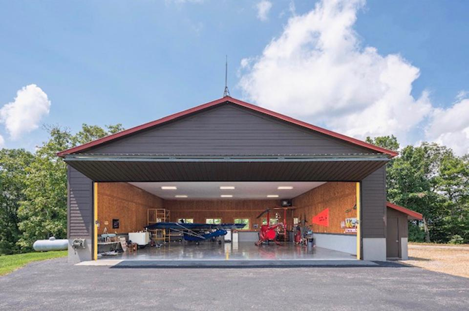 This contemporary aircraft hangar allows High Mountain's owner to come and go as he/she pleases.