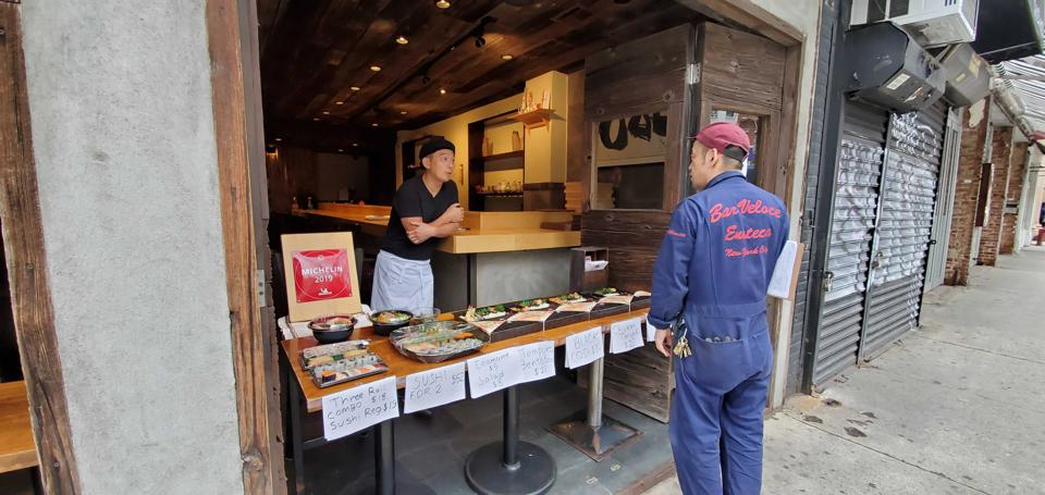 Michelin-starred restaurant Kanoyama shifts their business to take-out only, promoted through a street-side table.