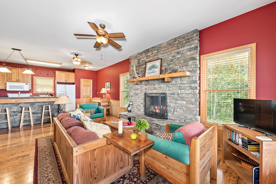 Cabin 2's living space with stone fireplace and kitchen island.