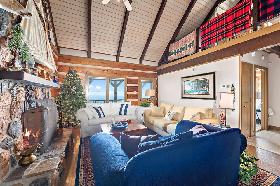 Cabin 3 mixes contemporary materials with traditional features like stone fireplaces and wood floors.