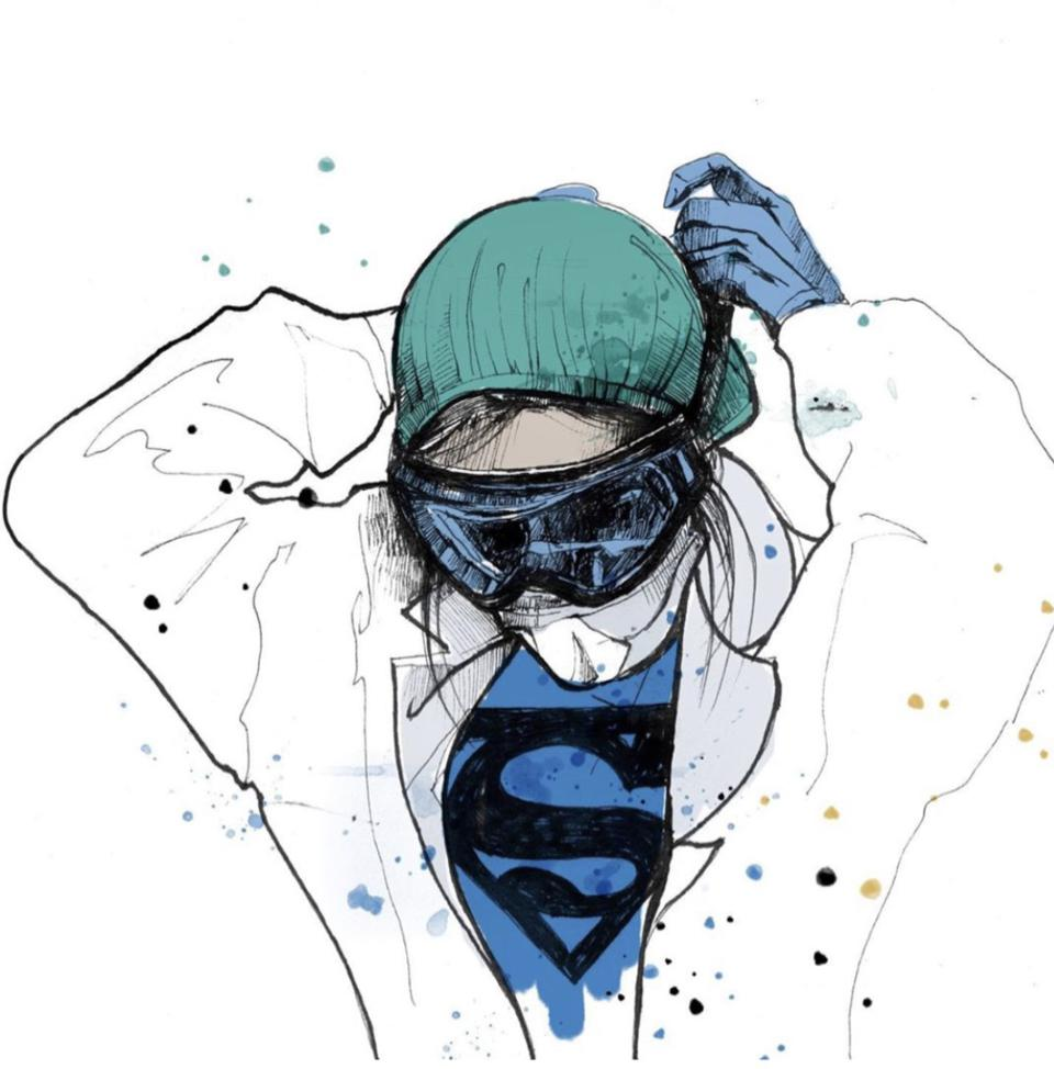 Doctor in white coat with Superman Shirt underneath, wearing a cap and donning goggles.