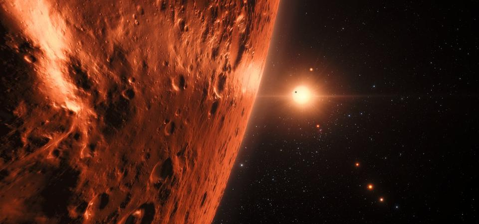 This artist's impression shows the view from the surface of one of the planets in the TRAPPIST-1 system.