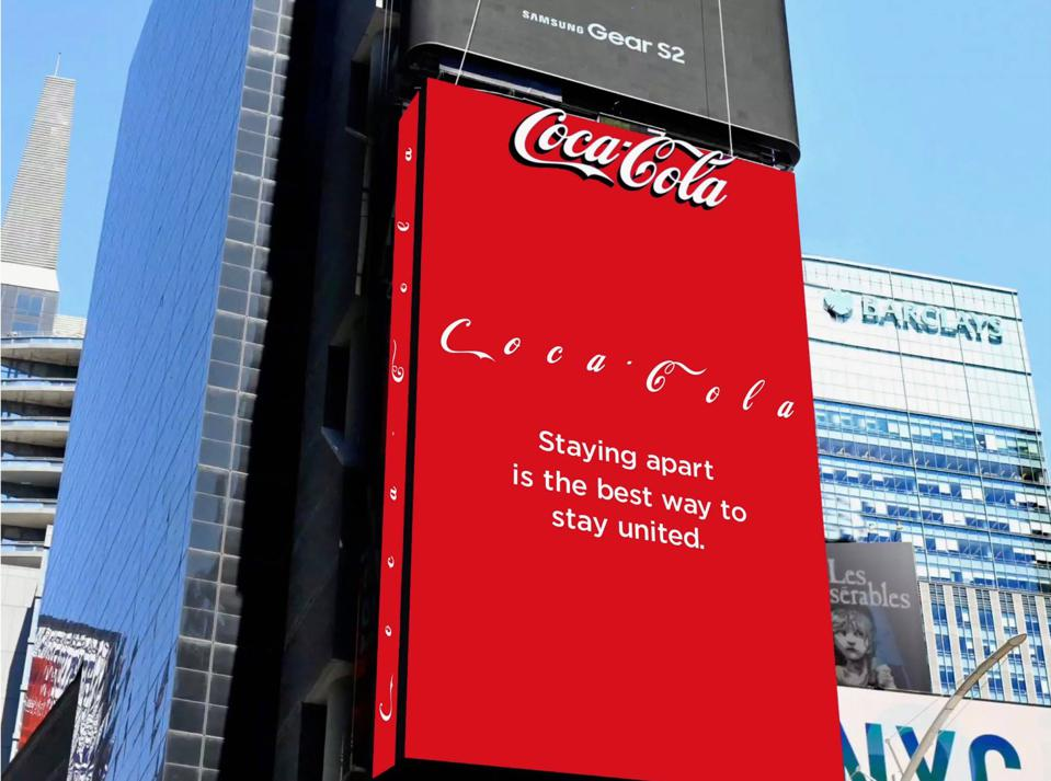A Coca-Cola billboard which says 'staying apart is the best way to stay united'