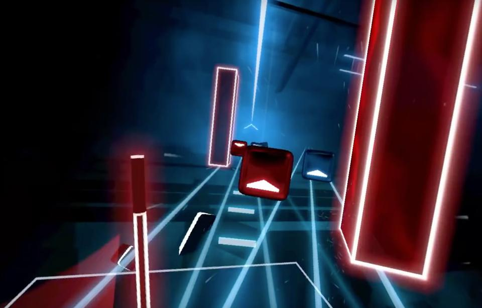 In-game footage of shapes in Beat Saber that players slice with virtual lightsabers.