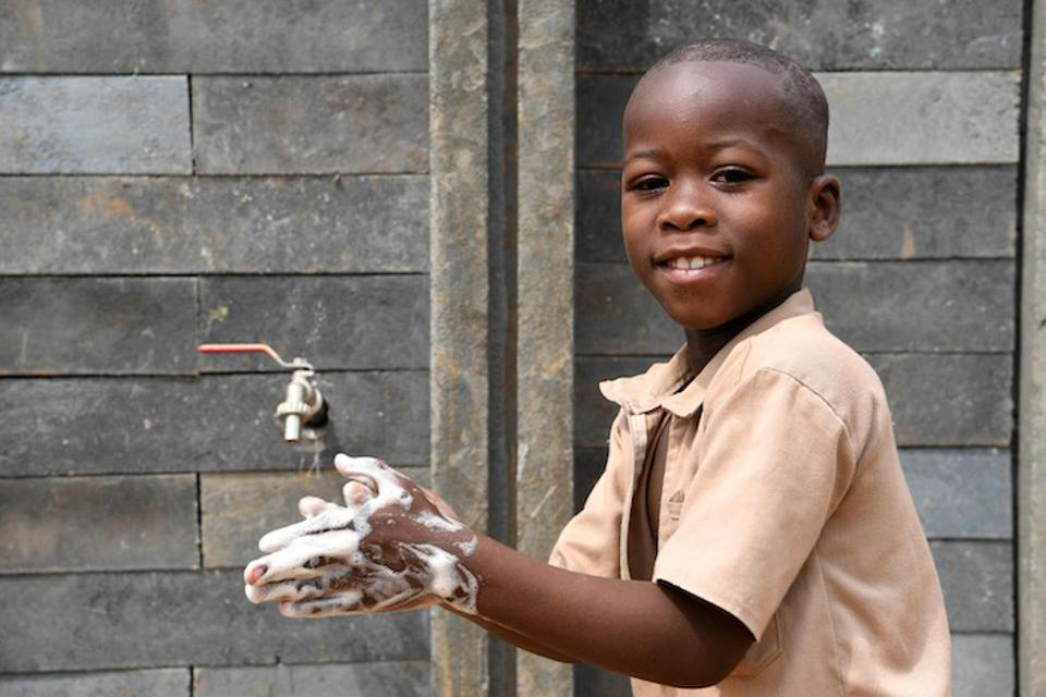 Frequent handwashing — with suds up to the wrists and between the fingers — is the key to coronavirus protection. This little boy from Côte d'Ivoire shows how it's done.