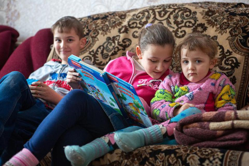 Children like (from left) Sergiy, 11, Tanya, 10, and Anna, 4, whose lives have been upended by the conflict in Ukraine, need extra reassurance during emergencies.