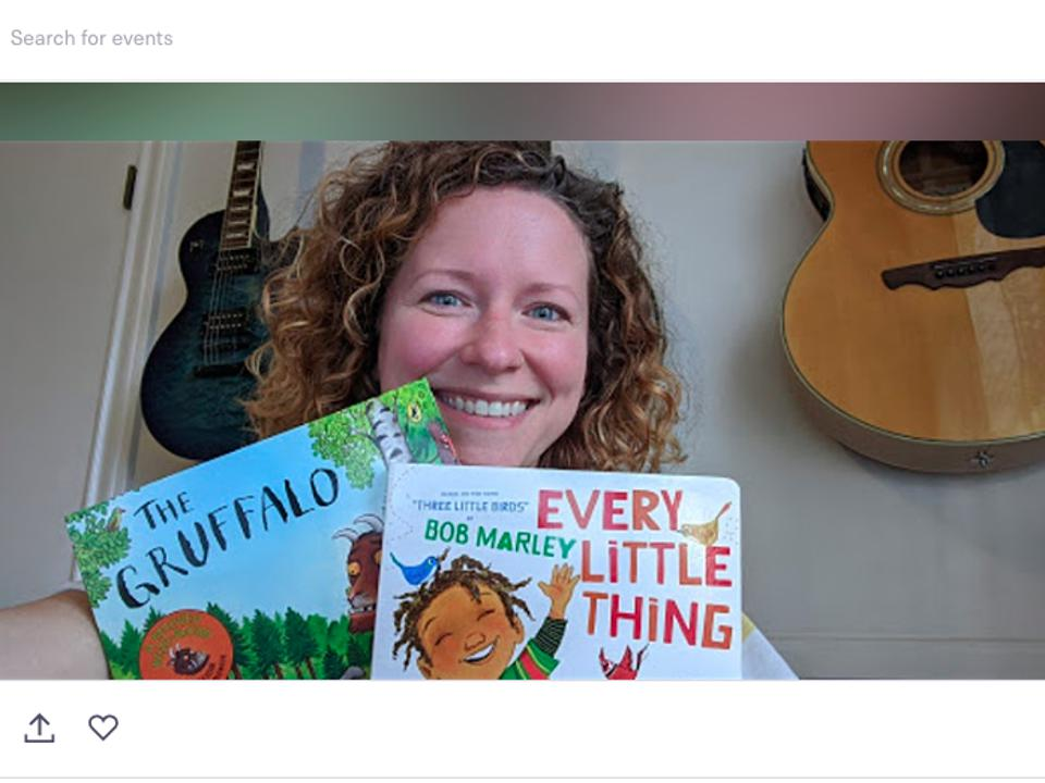 Screenshot of Tinius holding up two children's books to the camera.