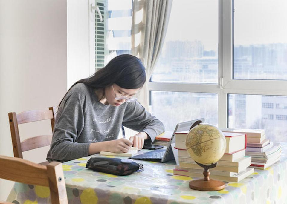 On February 18, 2020 in Beijing, Xiaoyu starts the day at 8 AM. She logs in to an online platform launched by the Ministry of Education (MOE) and the Ministry of Industry and Information Technology.