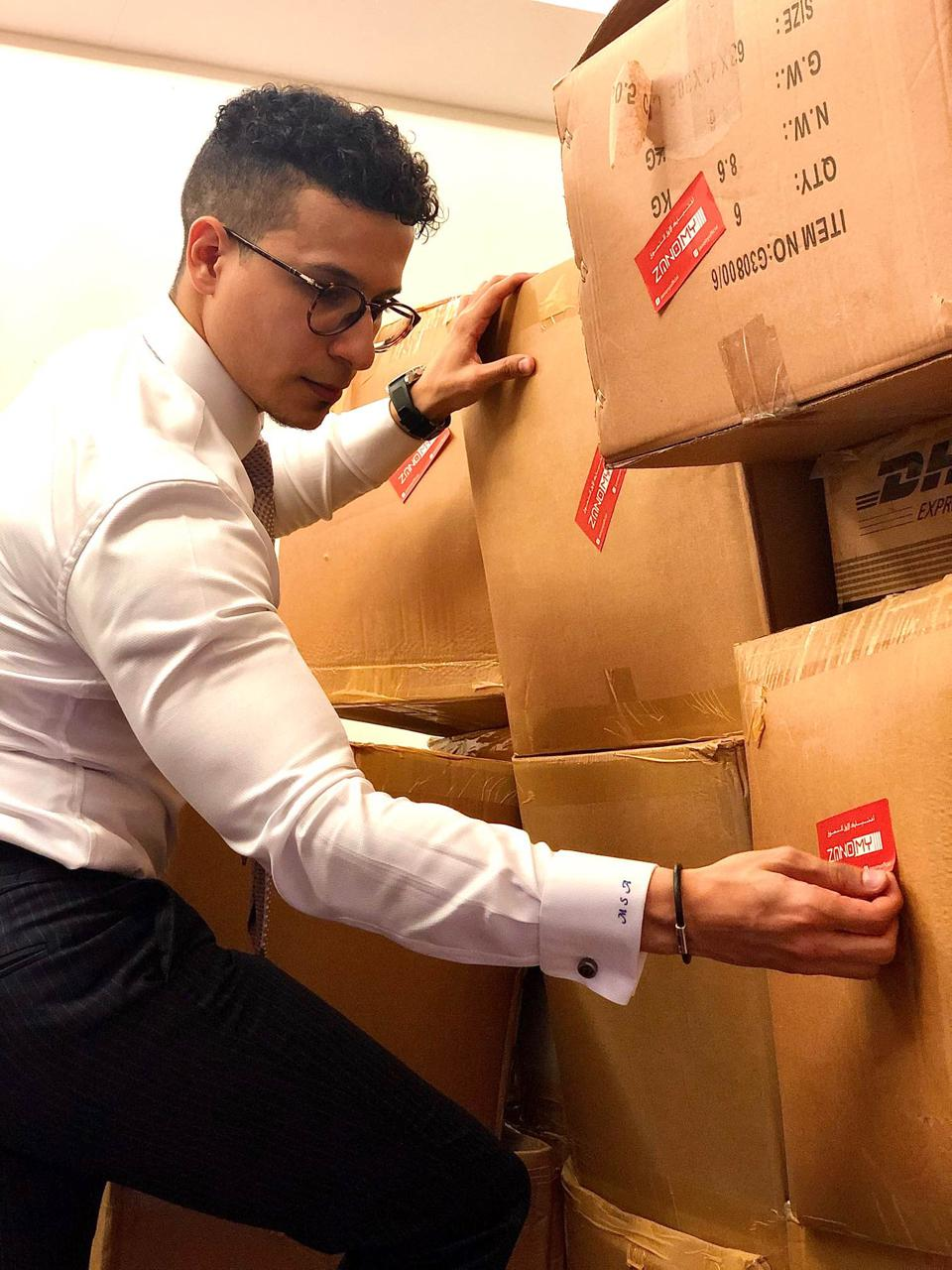 Muhanad Saleh, founder and chief executive of Zanomy, packing boxes before sending them on to customers in Libya.
