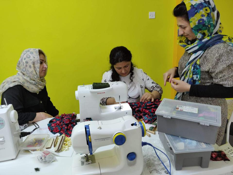 A group of women sewing at the Refugee Support Dignity Center in Nicosia, Cyprus