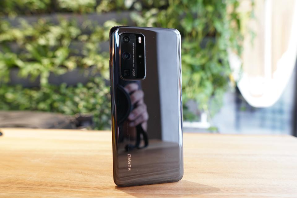 The Huawei P40 Pro has a shiny, reflective glass back.