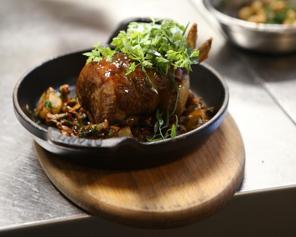 Pigeon stuffed with foie gras, pan-fried mushrooms and gravy