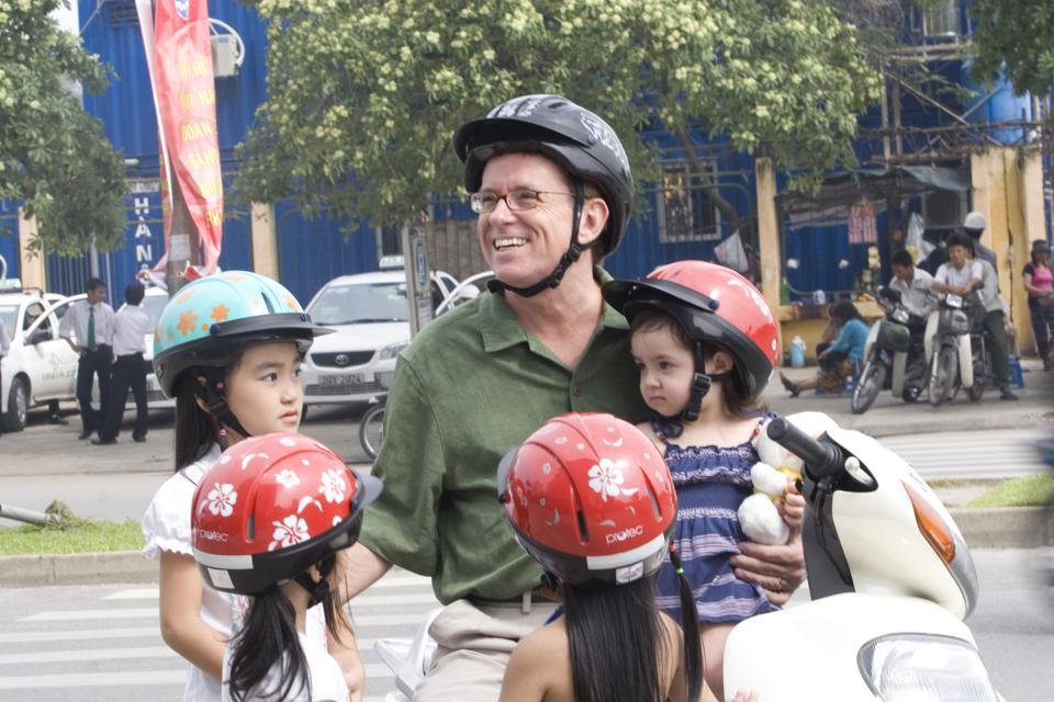 Greig Craft with children in Vietnam.