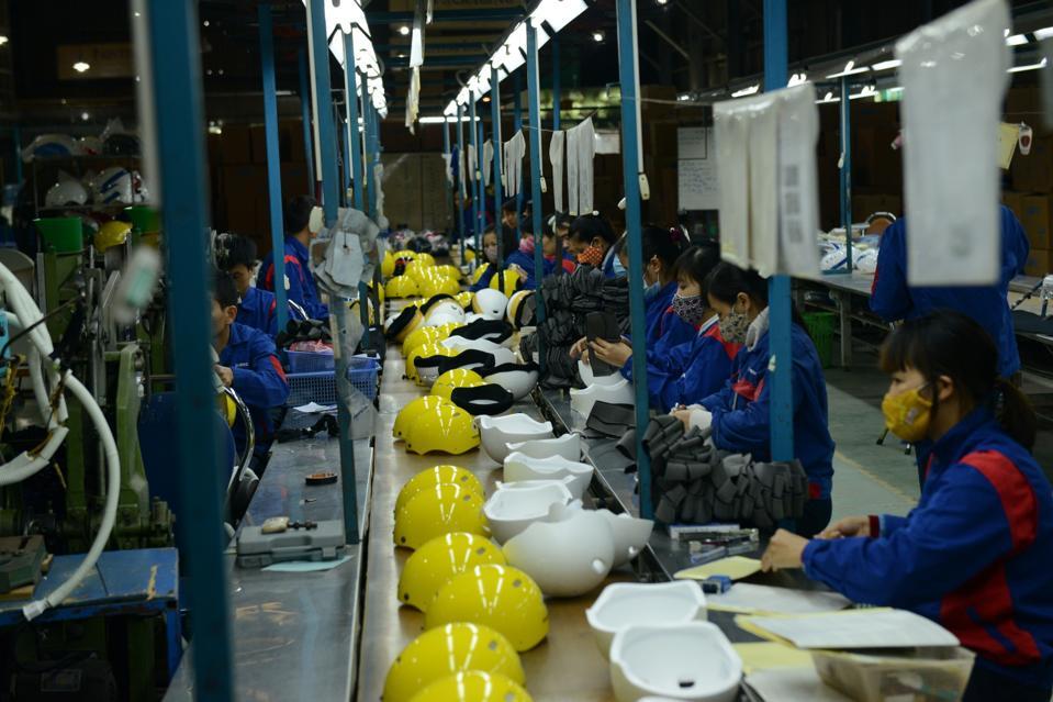 Helmets on the production line in Hanoi.