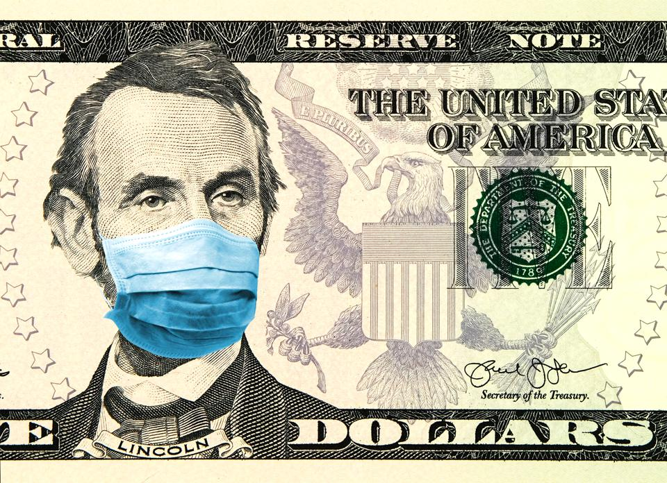 Coronavirus Wuhan Sars illness. Concept for quarantine in the United States. 5 dollar banknote where Lincoln wears a face mask. Digital montage.