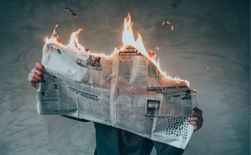 A newspaper on fire