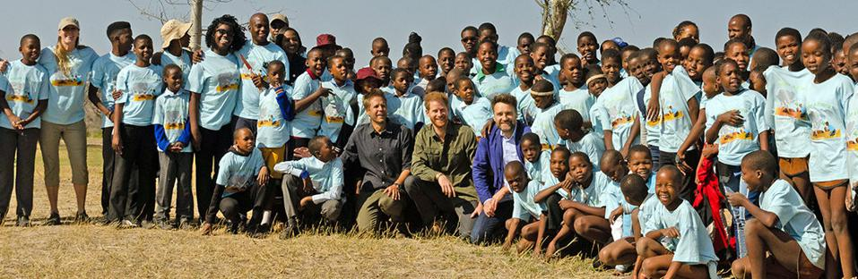 Prince Harry with students in Africa