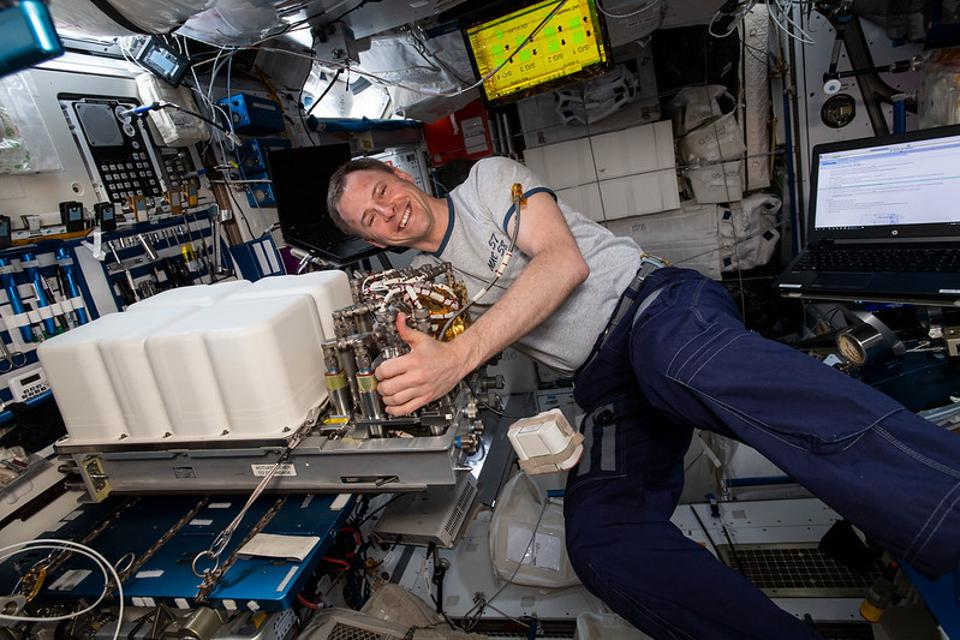 A weightless Nick Hague aboard the International Space Station.