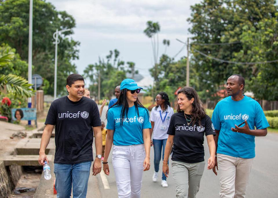 UNICEF USA and NextGen members walk back into town after visiting a family in Rwanda's Rubavu district to learn how community health workers educate communities on Ebola prevention.