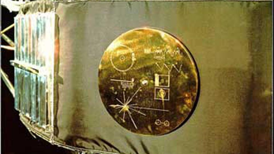 Color photo of golden record cover attached to Voyager spacecraft.