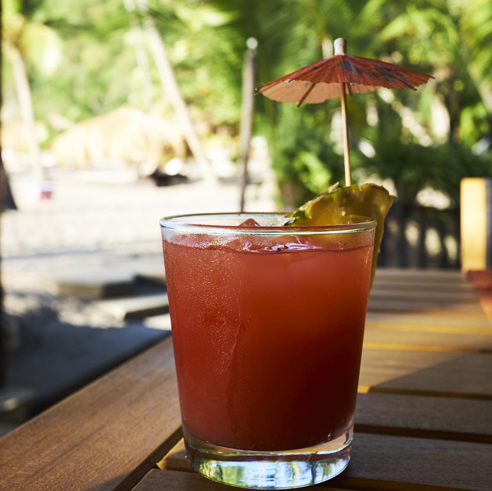 Tropical rum punch cocktail at the beach, Saint Lucia, Caribbean