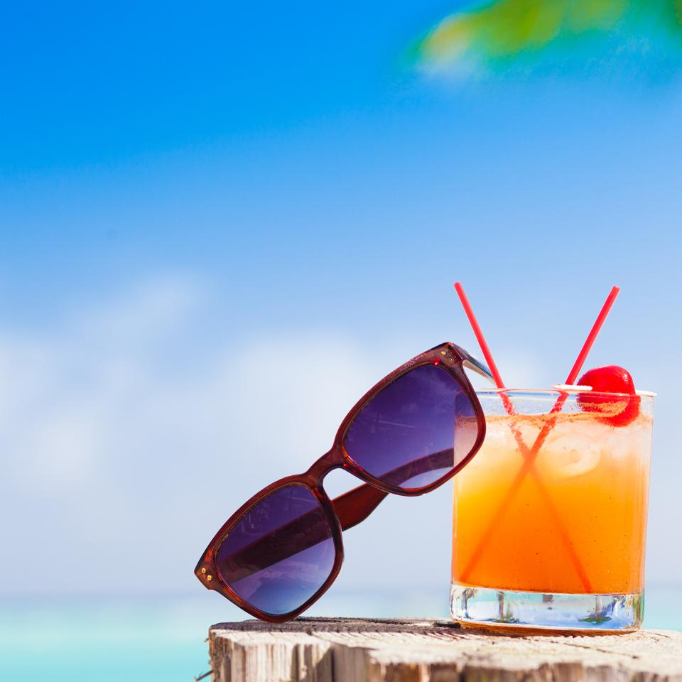 cocktail and sunglasses at beach- Barbados