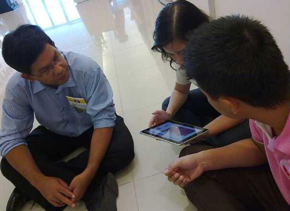 group sitting on hospital floor