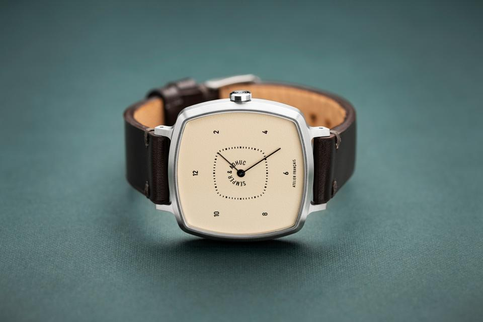 Semper & Adhuc timepiece; brushed steel, cushion-shape case with leather strap.