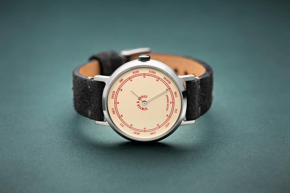 Semper & Adhuc brushed steel timepiece on leather strap.