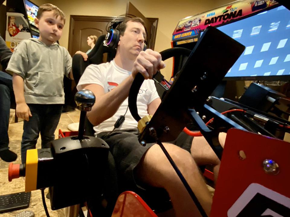 Reigning NASCAR champion Kyle Busch plays while son Brexton waits his turn.