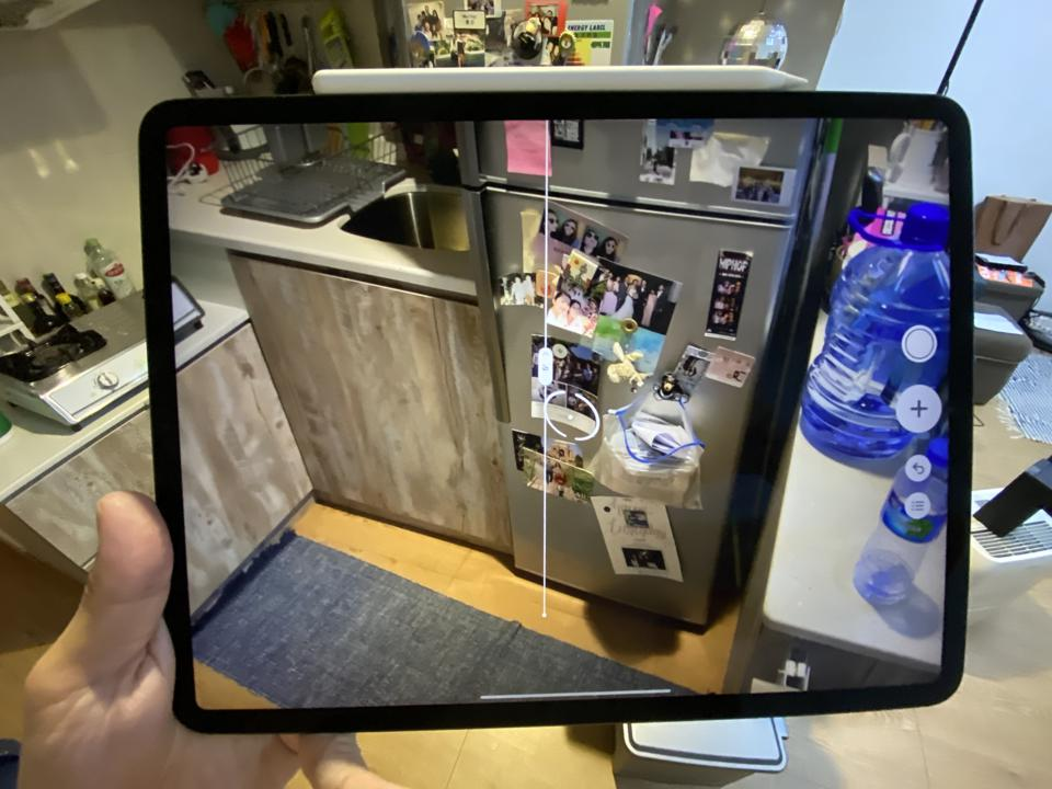 The iPad Pro 2020 using the Measure app to measure the length of my refrigerator.